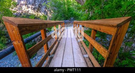Bridge with rails on a rocky terrain in Provo - Stock Photo
