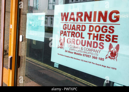 United Kingdom Great Britain England, London, Southwark, storefront window, sign, warning, security guard dogs patrol, sightseeing visitors travel tra - Stock Photo