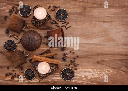 Vintage composition with rusty metal, candles and spices, on wooden background with copy space. - Stock Photo