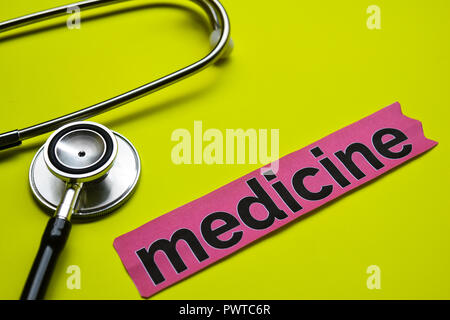 medicine with stethoscope concept inspiration on yellow background - Stock Photo