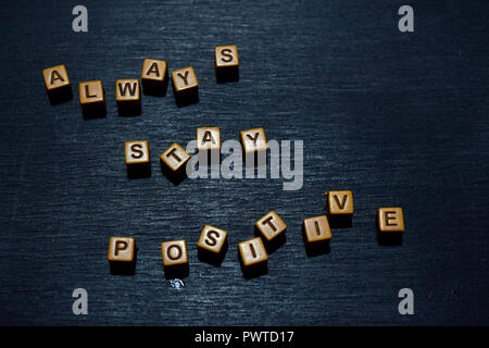 Always stay positive message written on wooden blocks. Motivation concepts. Cross processed image - Stock Photo