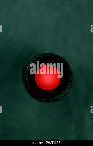 A photo of a vibrant red button, shot from above, a kill switch on a dark panel with a place for text - Stock Photo