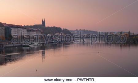 Autumn morning over misty Vysehrad church and reflection of railway bridge. Prague, Czech Republic - Stock Photo
