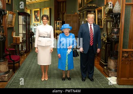 U.S First Lady Melania Trump, Her Majesty Queen Elizabeth II and President Donald Trump at Windsor Castle July 13, 2018 in Windsor, United Kingdom. - Stock Photo