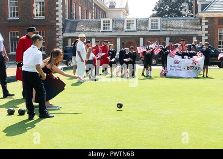 U.S First Lady Melania Trump tries her hand at bowls during a visit to the Royal Hospital Chelsea July 13, 2018 in London, United Kingdom. - Stock Photo