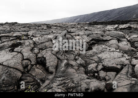 View of massive pahoehoe lava flow in Volcano National Park, on Hawaii's Big Island - Stock Photo