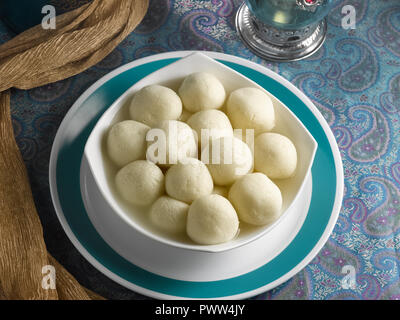 RASGOOLA, AN INDIAN DESSERT MADE FROM COTTAGE CHEESE SOAKED IN SUGAR SYRUP - Stock Photo