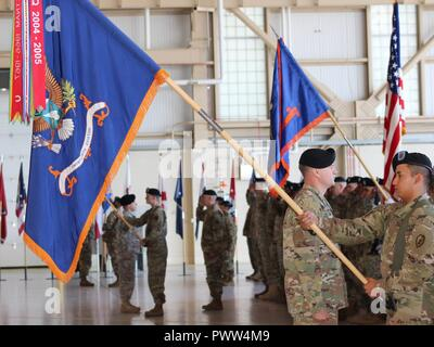 U.S. Army Alaska Aviation Task Force Soldiers honor the official party of USARAK Commander Maj. Gen. Bryan Owens, Outgoing UATF Commander Col. Blake Alexander and Incoming UATF Commander Col. Glen Heape at the UATF change of command June 29 at Fort Wainwright, Alaska. - Stock Photo