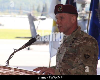 U.S. Army Alaska Commander Maj. Gen. Bryan Owens bids Outgoing USARAK Aviation Task Force Commander Col. Blake Alexander farewell and welcomes Incoming UATF Commander Col. Glen Heape to Alaska at the UATF change of command June 29 at Fort Wainwright, Alaska. - Stock Photo