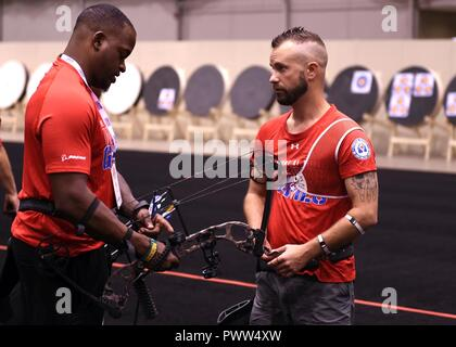 CHICAGO (June 29, 2017) – Retired U.S. Marine Corps Sgt. Leon Pierce (left) speaks with retired U.S. Marine Corps Staff Sgt. Matthew Francis (right) while attending practice for Team Marine Corps during the Department of Defense Warrior Games in Chicago, June 29. The DoD Warrior Games are an annual event allowing wounded, ill and injured service members and veterans to compete in Paralympic-style sports including archery, cycling, field, shooting, sitting volleyball, swimming, track and wheelchair basketball. ( - Stock Photo