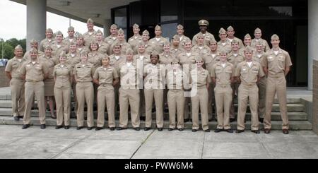 VIRGINIA BEACH, Va. (June 28, 2017) Students from the Information Professional Basic Course and Naval Intelligence Officer Basic Course at Information Warfare Training Command (IWTC) Virginia Beach pose for a photo with course instructors and IWTC Virginia Beach leadership prior to their graduation ceremony. ( - Stock Photo
