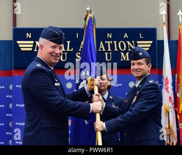 Col. Joel Carey, 12th Flying Training Wing commander, passes the guidon to Col. Charles McElvaine as he assumes command of the 479th Flying Training Group during a change of command ceremony June 30, 2017 at the National Naval Aviation Museum, Naval Air Station Pensacola, Fla. - Stock Photo