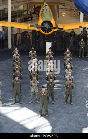 Members of the 479th Flying Training Group in formation stand at parade rest during the change of command ceremony June 30, 2017 in the National Naval Aviation Museum at Naval Air Station Pensacola, Fla. - Stock Photo