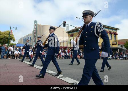 Members of the Coast Guard Ceremonial Honor Guard march in a fourth of July parade in Alameda, California, a Coast Guard City, July 4, 2017. - Stock Photo