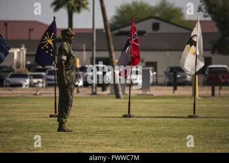 U.S. Marine Corps Staff Sgt. Matthew Bradley, the adjutant for the ceremony, calls troops to order during Sgt. Maj. Delvin R. Smythe's, the Marine Corps Air Station Yuma, Ariz., sergeant major, retirement ceremony, June 30, 2017. - Stock Photo