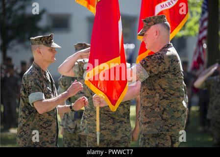 Major General Russell Sanborn, the oncoming commander of Marine Forces Europe and Africa (MARFOREUR/AF), prepares to receive the colors from Maj.Gen. Niel Nelson, the off-going commander, during change of command ceremony on Panzer Kaserne, Stuttgart, Germany, July 5, 2017. Sanborn took over command of MARFOREUR/AF from Nelson, who is slated to become deputy commanding general of Marine Corps Combat Development Command. - Stock Photo