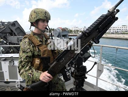 KEY WEST, Fla. (July 6, 2017) Master-at-Arms 2nd Class Laura Kelley, assigned to Coastal Riverine Group One detachment Guam, stands watch as USNS Spearhead (T-EPF 1) departs Key West.  SPS-EPF 17 is a U.S. Navy deployment, executed by U.S. Naval Forces Southern Command/U.S. 4th Fleet, focused on subject matter expert exchanges with partner nation militaries and security forces in Central and South America.  ( - Stock Photo
