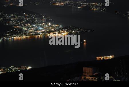 aerial night view,Town of Baveno on Lago Maggiore, Italy - Stock Photo