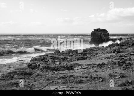 Pultpit  rock and  trinity monument Dorset  Portland bill - Stock Photo