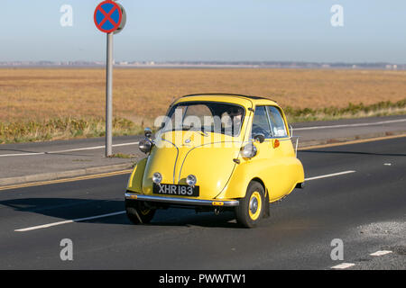 Yellow Isetta standard Bubble car on Southport, Seafront Promenade, UK - Stock Photo