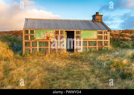 An old shieling or shepherds hut on the Isle of Lewis in Scotland - Stock Photo