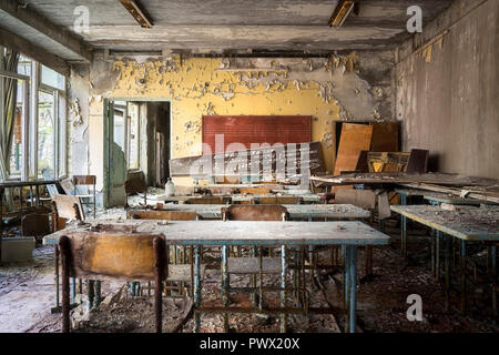 Interior view of a music classroom in an abandoned school in Chernobyl, Ukraine. - Stock Photo