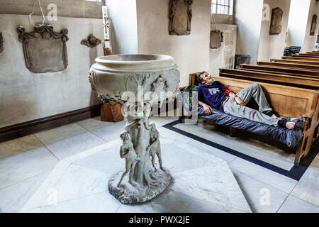 London England United Kingdom Great Britain West End St James's Piccadilly Church St James-in-the-Fields Anglican Church parish interior pews homeless - Stock Photo