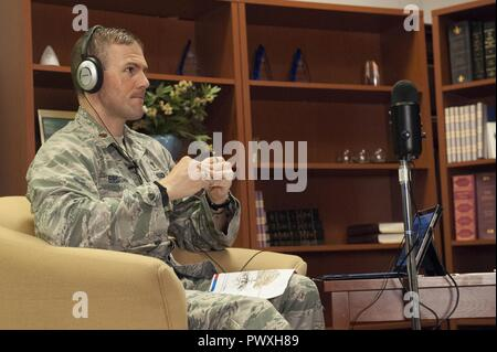 """Chaplain (Maj.) Jim Bridgeham, 363rd Intelligence, Surveillance, and Reconnaissance Wing chaplain, hosts an episode of the resilience podcast, """"The Pillars,"""" at Joint Base Langley-Eustis, Virginia, July 6, 2017. The 363rd ISR Wing is spread across several bases and mission locations, and the podcast has been a great format for those Airmen to be included in resilience training. (United States Air Force - Stock Photo"""