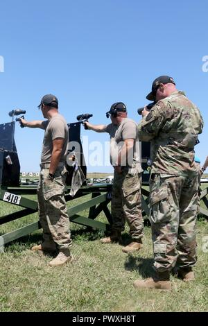 Sergeants 1st Class Lawrence Cleveland and James Henderson, both with the U.S. Army Marksmanship Unit Service Pistol Team, fire their pistols while Sgt. 1st Class Patrick Franks, a Las Vegas, Nevada native and team captain, watches their accuracy with a scope. The Service Pistol Team competed in the National Pistol Matches at Camp Perry, Ohio from June 30 to July 2, 2017. Henderson, a Pasadena, California native, earned the Overall Individual Championship title as well as his 10th President's 100 Match Champion title. Cleveland, a Tacoma, Washington native, won the .22 Rim Fire Match Champion  - Stock Photo