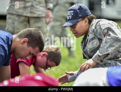 U.S. Air Force Reserve Tech. Sgt. Kristen Howard, a member of the 910th Medical Squadron, supervises Junior Reserve Officer Training Corps (JROTC) cadets doing physical training during an encampment here, June 21, 2017. The encampment, facilitated by 910th Airlift Wing Airmen, provided a five-day experience teaching military skills and replicating aspects of Basic Military Training. JROTC is a program sponsored by the Armed Forces for high school students across the country. - Stock Photo