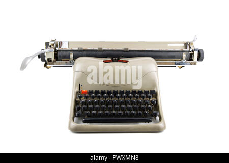 front view of a vintage typewriter isolated in white background - Stock Photo