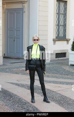 MILAN, ITALY - SEPTEMBER 21, 2018: Caroline Daur before Tods fashion show, Milan Fashion Week street style