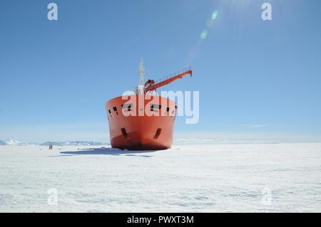 Progress station, Antarctica, January 10, 2017: The cargo ship costs at the floe under unloading. Antarctic. - Stock Photo