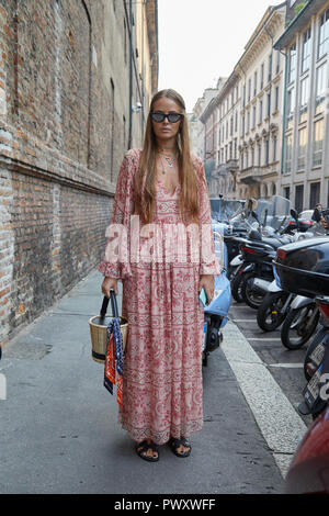 MILAN, ITALY - SEPTEMBER 21, 2018: Carlotta Oddi before Blumarine fashion show, Milan Fashion Week street style