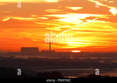 Eggborough Power Station, Leeds. 18th Oct 2018. UK Weather: Sunrise over Eggborough Power Station from Rothwell Country Park in Leeds Credit: Yorkshire Pics/Alamy Live News - Stock Photo