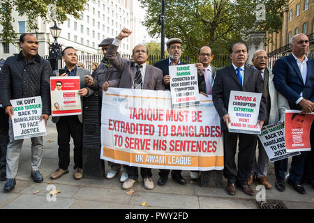 London, UK. 18th October, 2018. Campaigners from the UK Awami League, supporters of the current Government of Bangladesh under Prime Minister Sheikh Hasina, protest in Whitehall opposite Downing Street to call on the British Government to extradite Tarique Rahman, acting chairman of Bangladesh Nationalist Party, to Bangladesh. Tarique Rahman successfully applied for political asylum in the UK in 2008 and has since been granted indefinite leave to remain. Credit: Mark Kerrison/Alamy Live News - Stock Photo