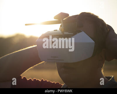 Kiev, Ukraine. 18th Oct, 2018. Drone pilot seen wearing a first-person view headset. Young man driving a quad-copter using video-goggles Credit: Igor Golovniov/SOPA Images/ZUMA Wire/Alamy Live News - Stock Photo
