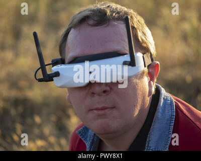 Kiev, Ukraine. 18th Oct, 2018. Drone pilot seen wearing a first-person view headset. Young man driving a quad-copter using video-goggles. Credit: Igor Golovniov/SOPA Images/ZUMA Wire/Alamy Live News - Stock Photo