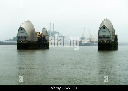 The Thames Barrier Flood Defences in the River Thames near Greenwich and Silvertown Greater London England United Kingdom - Stock Photo