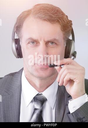 closeup .portrait of confident employee call center - Stock Photo