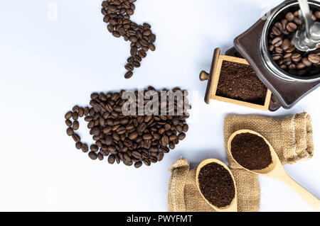 coffee beans in coffee cup shaped with wooden grinder and sack - Stock Photo