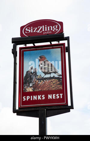 Sign for the Spinks Nest public house in Huddersfield showing  a Chaffinch and young, historically called Spinks - Stock Photo