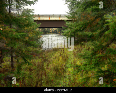 A woodland path leading to a river in The Adirondack Mountains of New York State - Stock Photo
