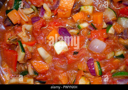 background of ratatouille cooking in a pan - Stock Photo
