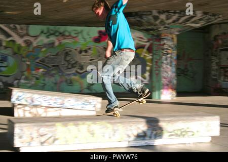 A young skateboarder showing off his skills at the undercroft of the Southbank Centre, London. - Stock Photo