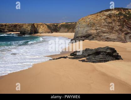 Portugal South-West Alentejo and Vicentine Coast Natural Park cliff top view of a pristine deserted beach in Porto Covo. - Stock Photo