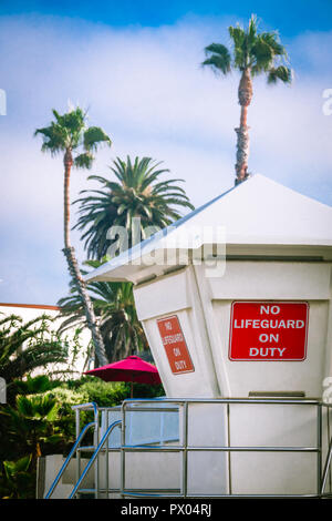 No Lifeguard on Duty Sign on a Life Guard Station in Laguna Beach, California - Stock Photo