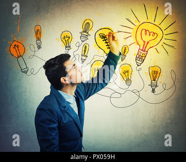 Thoughtful businessman drawing imaginative shining light bulbs. Different business thinking, genius creativity concept, alternative idea as the way to - Stock Photo