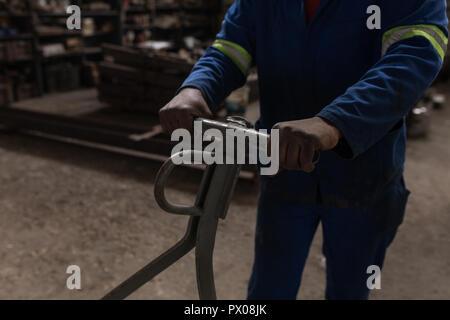 Blacksmith working in workshop - Stock Photo