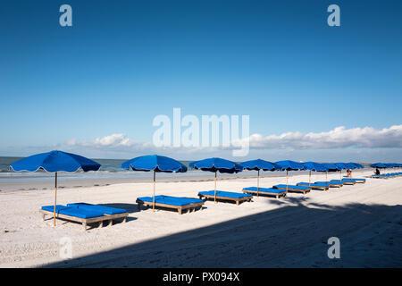 Redington Beach, Florida, USA., Thursday, 11th October, 2018, Blue Beach Umbrella's, Sun beds, moving out of the Shadows, © Peter SPURRIER, - Stock Photo